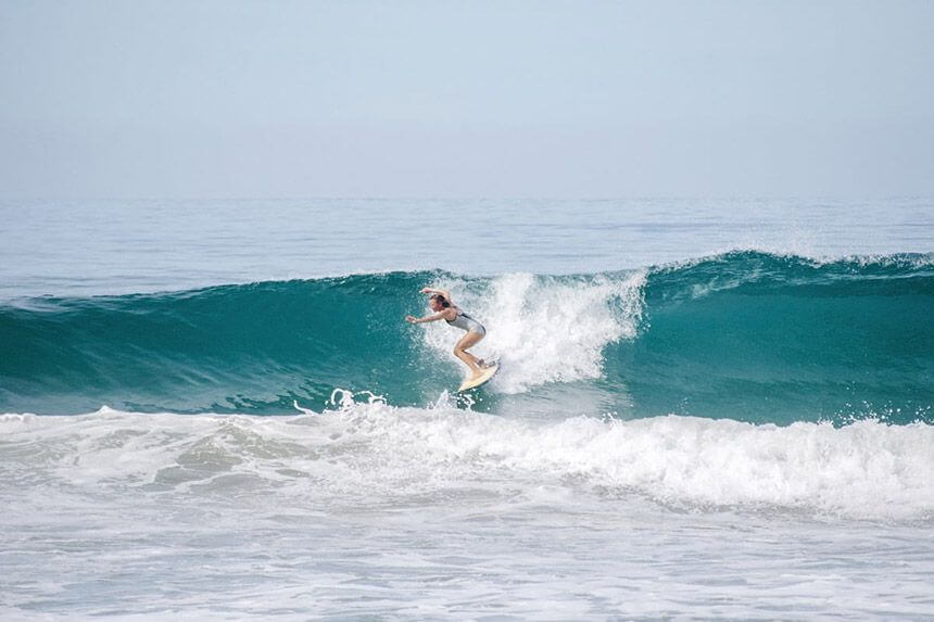 Surfing woman in Mexico